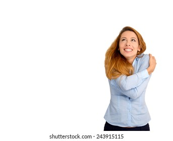 Closeup portrait confident woman holding hugging herself looking up at copy space isolated on white background. Positive emotion facial expression feeling reaction. Love yourself concept