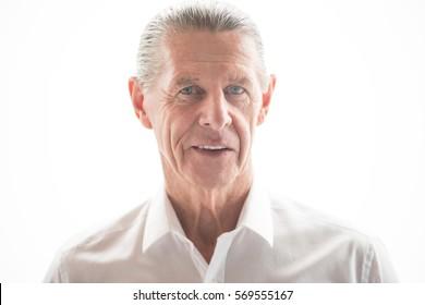 Closeup Portrait of Content Friendly Senior Man