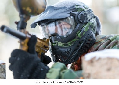 Closeup portrait of cool girl in paintball mask outdoors