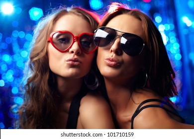 Close-up portrait of cool girls at nightclub