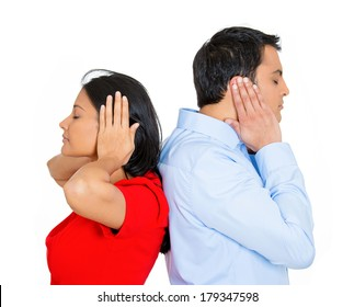 Closeup portrait of couple, man, woman standing with backs together, covering ears, closed eyes, not listening to each other isolated on white background. Negative human emotions, facial expressions