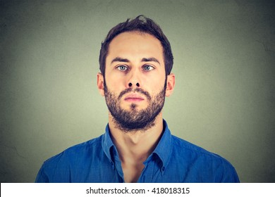 Closeup portrait of a cross-eyed man