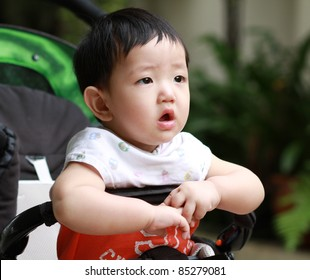 Closeup portrait of cute baby boy is looking up and thinking