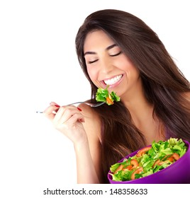 Closeup portrait of cute girl eating salad isolated on white background, enjoying fresh tasty vegetables with closed eyes, healthy lifestyle concept