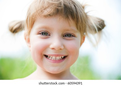 Close-up portrait of a cute liitle girl