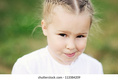 Closeup portrait of cute little blond girl