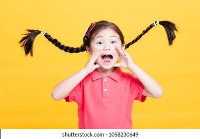 Closeup portrait of cute little girl yelling