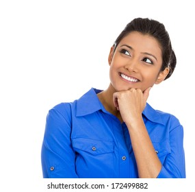 Closeup portrait of cute pretty smiling young woman, student thinking, hand on cheek looking up having an idea, isolated on white background. Positive emotions, facial expressions, feelings, attitude
