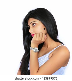 Closeup portrait of cute pretty smiling young indian woman thinking hand on chin looking up having an idea, isolated on white background.