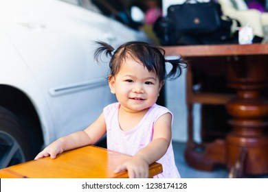 Closeup portrait of cute smiling girl.Smiling girl isolated at outside the house
