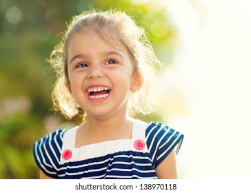 Close-up Portrait of Cute Smiling Little Girl