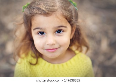 Close-up portrait of cute toddler girl