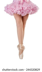Closeup portrait of a dancer in ballet shoes dancing in Pointe. Isolated.