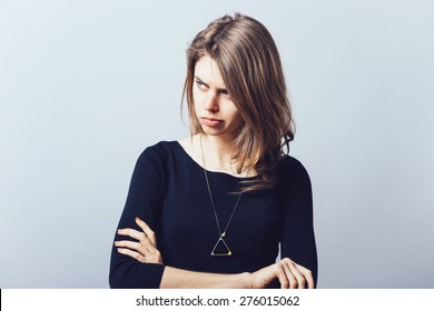 Closeup portrait displeased pissed off angry grumpy pessimistic woman with bad attitude, arms crossed looking at you Negative human emotion facial expression feeling