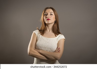 Closeup portrait displeased, pissed off, angry, grumpy, pessimistic, arrogant, woman with bad attitude, arms crossed looking at you. Negative human emotion, facial expression feeling