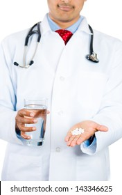 Closeup portrait of doctor holding glass of water in one hand and white pills in the other for euthanasia, isolated on white background