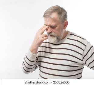 Closeup portrait of an elderly executive, old corporate employee, grandfather with closed eyes, in a melancholic mood, daydreaming, looking clueless, isolated on a white background. Human emotions