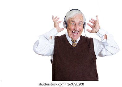 Closeup portrait of an elderly man, senior executive, retired guy, grandpa with headphones listening to the radio, enjoying music and his life, isolated on a white background. Positive human emotions