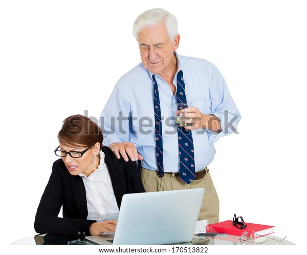 Closeup portrait of elderly senior mature man, ceo, executive, leader making advances on his young secretary worker who is working on laptop, isolated on white background. Scandals at the workplace