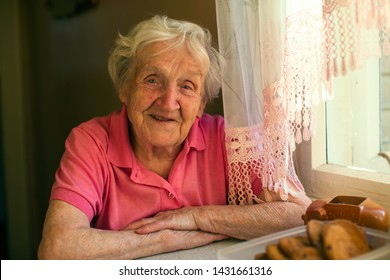 Close-up portrait of an elderly woman in her home.
