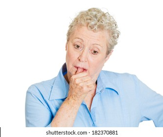 Closeup portrait elderly woman, old corporate employee, confused grandmother, melancholic mood, daydreaming looking clueless sucking up thumb, isolated white background. Human emotion, face expression