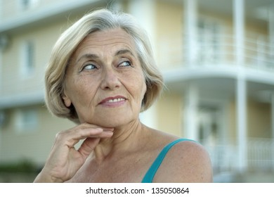 close-up portrait of an elderly woman on walk in the summer