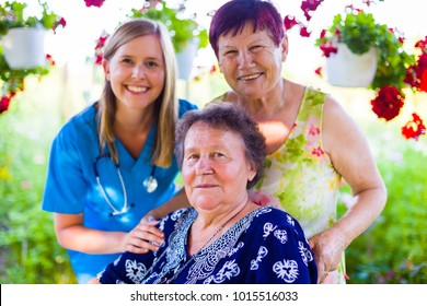 Close-up portrait of elderly women and caregiver at the nursing home.
