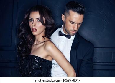 Closeup portrait of an elegant, stylish, young couple