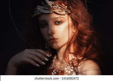 Close-up portrait of a enigmatic beautiful girl posing in a forest. Beauty, fashion. Cosmetics and makeup.
