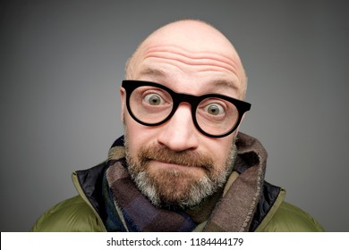 Closeup portrait of european funny bald mature man thinking trying hard to remember something looking confused isolated on gray background. Negative emotion facial expressions.