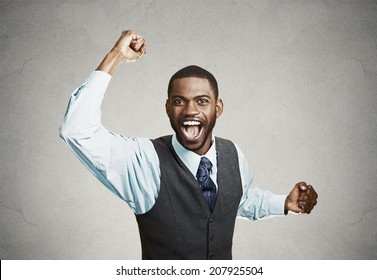 Closeup portrait excited, energetic, happy, screaming student, business man winning, arms, fists, hands pumped, celebrating success isolated grey background. Positive human emotion facial expression