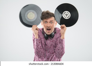 Closeup portrait of excited young DJ with stylish haircut, bow tie having fun with vinyl record showing Mickey Mouse ears isolated on white background