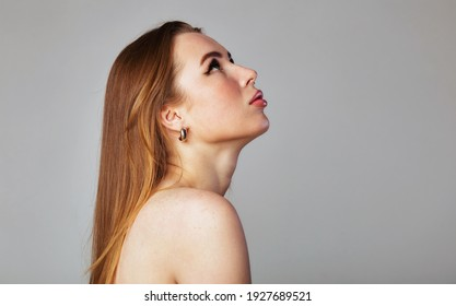 Closeup portrait of a face of the young pretty woman with a healthy skin. Beautiful face of young white woman with a clean skin. Skin care concept.