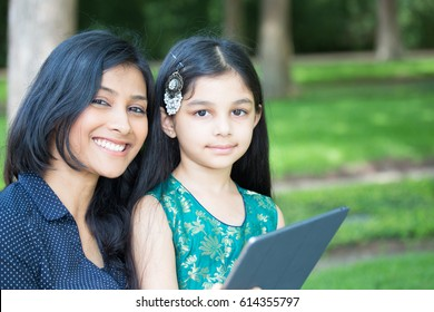 Closeup portrait, family holding tablet, using technology, isolated outdoors outside background