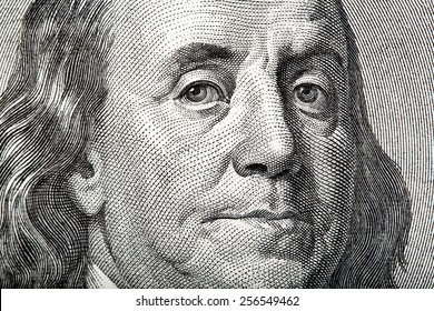 Close-up portrait of Franklin on American money.