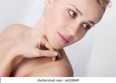 Closeup portrait of a fresh and beautiful young woman on a light background