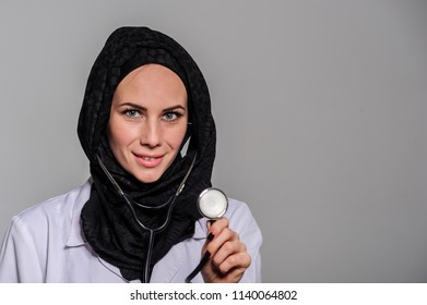 Closeup portrait of friendly, smiling confident Arabic female doctor, healthcare professional isolated on white background.