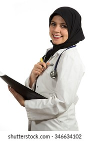 Closeup portrait of friendly, smiling confident muslim female doctor holding folder, healthcare professional isolated on white background.