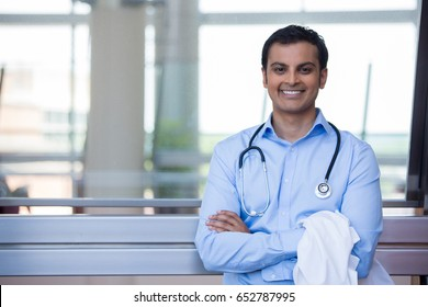 Closeup portrait of friendly, smiling confident male doctor, healthcare professional with stethoscope around neck, arms crossed.