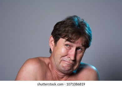 Close-up portrait of a frightened man. Fear of a man with a bare torso