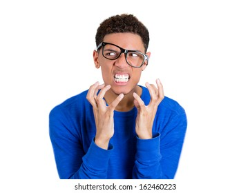 Closeup portrait of frustrated, angry nerdy man with hands raised and glasses messed up on face showing teeth, isolated on white background with copy space, Negative human emotions facial expressions