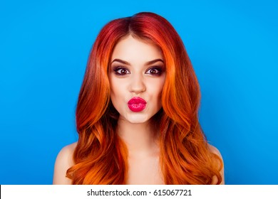 Close-up portrait of funny attractive cute girl with long ginger with dye ombre fair hair pout lips while standing on blue background