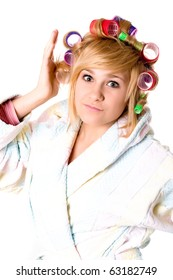 closeup portrait of funny housewife with curlers on white background
