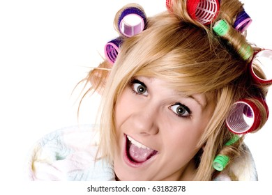 closeup portrait of funny housewife with curlers on white