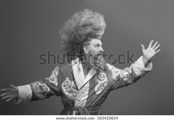 closeup portrait of funny Santa Claus with a mohawk on a gray background studio