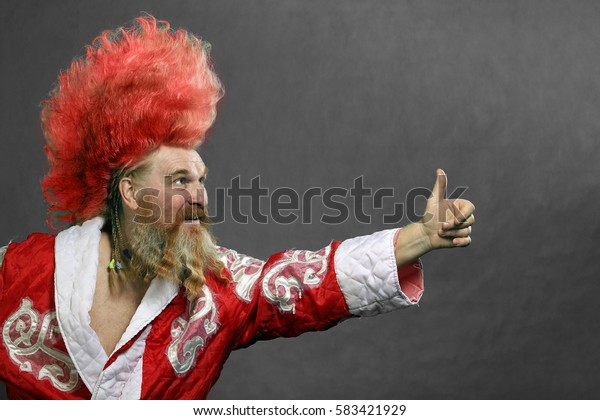 closeup portrait funny santa claus, red-haired man with long wavy hair and beard on white background studio
