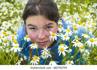 Close-up portrait. Girl in a blooming field