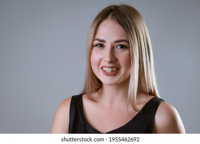 Close-up portrait of a girl with crooked teeth