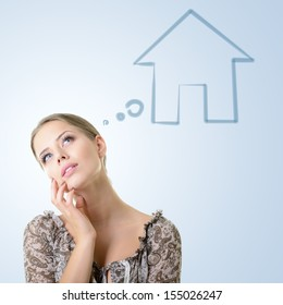 Close-up portrait of girl dreaming about house, isolated over blue background with copyspace