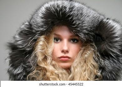 Closeup portrait of a girl in fir coat
